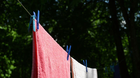 Laundry clip with pin dry hanging on clothesline in breeze Footage