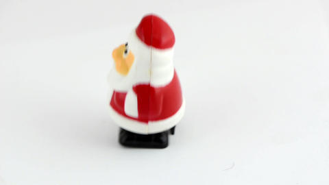Clockwork Santa Claus xmas toy walk on white background Footage