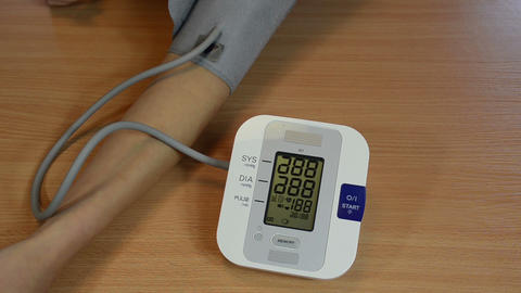 female patient checking measuring her blood pressure Footage