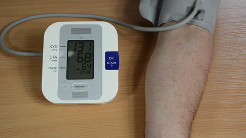 male patient measuring her blood pressure numbers vary Footage