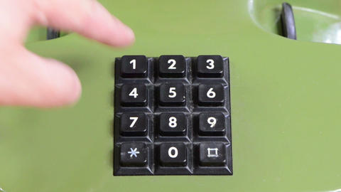 cropped shot of human finger pressing landline phone numbers ビデオ