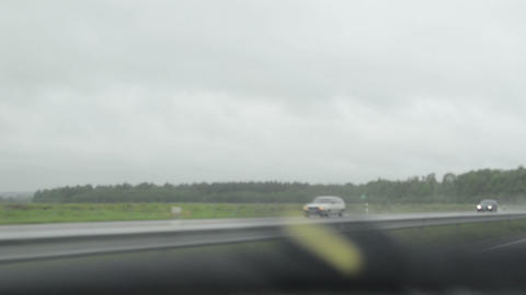 terrible weather condition. drive car on highway and rain fall Footage