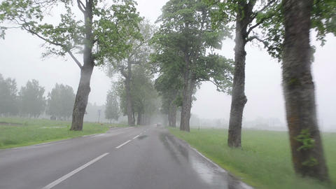 strong rain fall on car automobile windscreen driving on road Footage