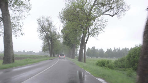 rainfall on car automobile windscreen drive on road Footage