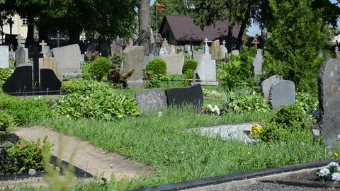 rural cemetery graves tomb stones panorama and old woman Footage