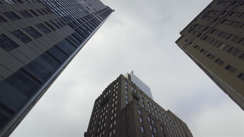 Panning shot of Skyscrapers from street level looking up 4K UHD Footage