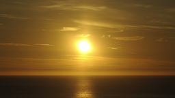 Timelapse Of A Sunset In 4K - The Sun Reflects On The Ocean, Goes Down And Disap stock footage