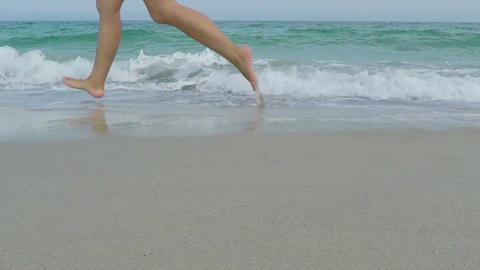 Woman Runs Along The Seashore stock footage