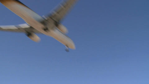 Airplane Flies By Lens (1 Of 4) stock footage