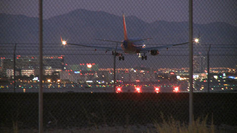 Plane lands in early evening (2 of 4) Footage