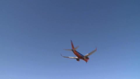Airplane flies by lens (3 of 4) Footage