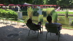 Couple Relaxing In The Tuilerie Gardens stock footage