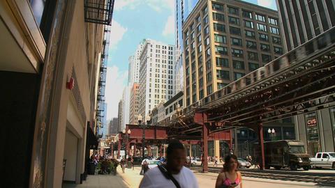 Pedestrians walk beneath Chicago's L (1 of 3) Footage