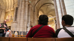 People Sitting In A Church From Low Angle stock footage