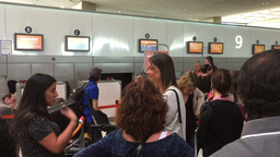 People Wait In Line For Check In Their Flight stock footage