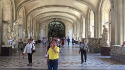 Visitors take pictures inside the Louvre museum in Paris Footage
