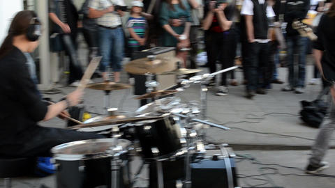 band of young teen people play drum guitar and sing hard rock Footage