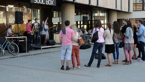 band sing play guitar drums in street Footage