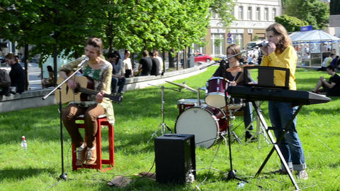 students sing romantic songs play guitar mouth organ old town Footage
