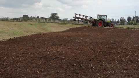 heavy machine tractor plow work field august Footage