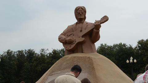 john lennon legend beatles leader sculpture sand people vilnius Footage