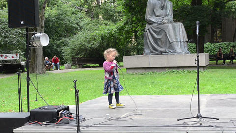 young girl kid sing and dance on scene with microphone Footage