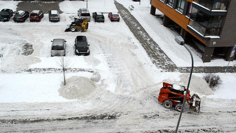 cars stand block house parking tractors clean winter snow Footage