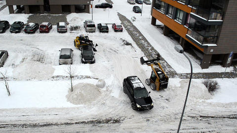 car pass between tractor clean flat house parking lot winter Footage