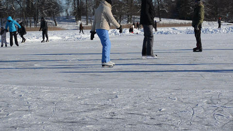 Active people recreate winter sport skate slide ice frozen lake Footage