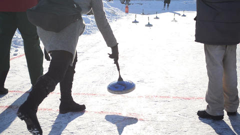 people throw pin figures play winter game curling eisstock ice Footage