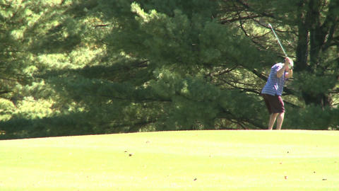 Golfer taking swing and follow-through Footage