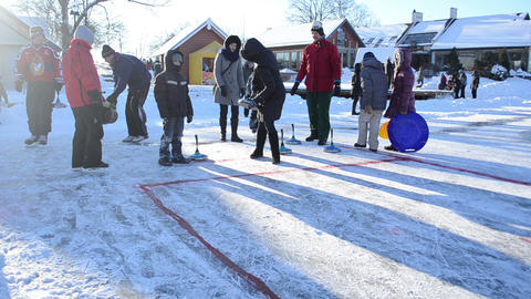 people play winter game curling eisstock frozen ice Trakai Footage