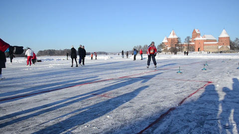 people play eisstock curling skate frozen lake ice Trakai winter Footage