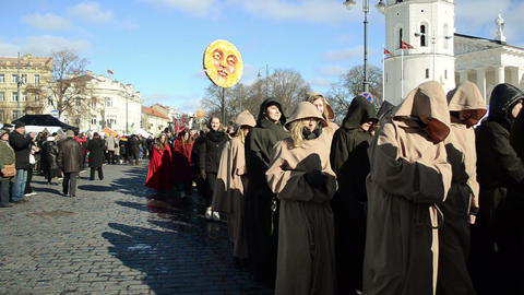 march goes the city street dressed monks and carries statue sun Footage