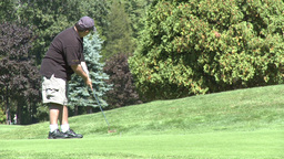 Golfer putts ball (1 of 2) Footage