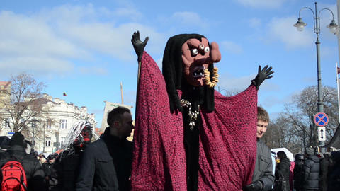 parade participants carries witch mask with a red cloak Footage