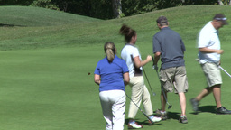 Female golfer putts ball and is excited (2 of 2) Footage