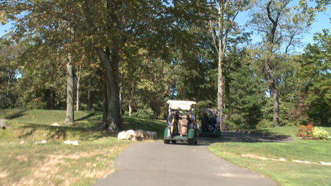 Following golf carts along path (2 of 4) Footage