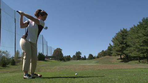 Female golfer missed hitting ball off tee Footage