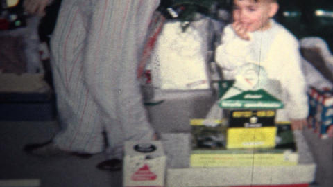 (8mm Vintage) 1964 Kids Playing Christmas Morning Presents Stock Video Footage