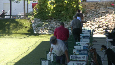 Golfers practicing at driving range (2 of 6) Stock Video Footage