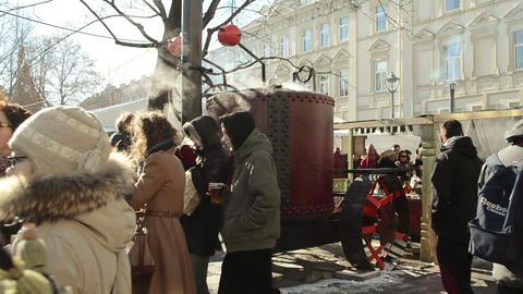 huge retro steel pot hot wine vapour rise people spring festival Footage