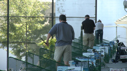 Golfers practicing at driving range (4 of 6) Stock Video Footage