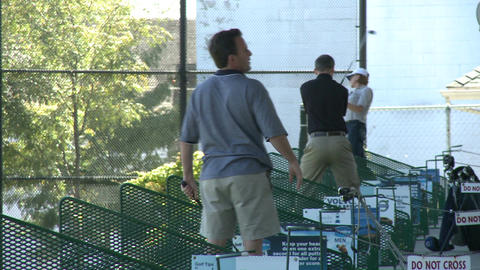 Golfers practicing at driving range (5 of 6) Stock Video Footage