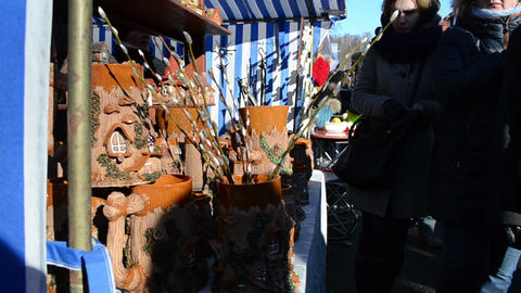 woman handmade crockery clay vases pots sell city market fair Footage