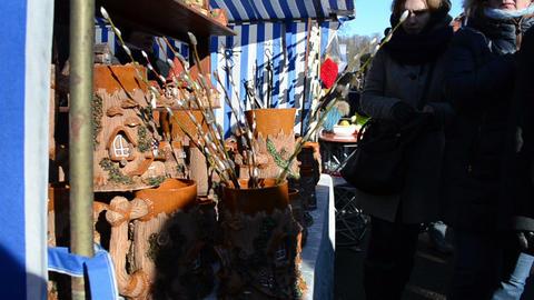 woman handmade crockery clay vases pots sell city market fair Footage