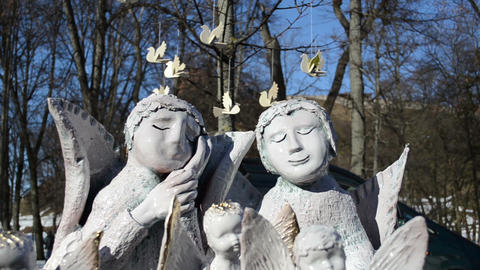 simpatico crockery clay angels sold fair market bird figures Stock Video Footage