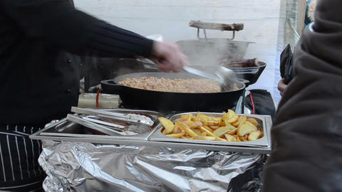 people buy pea potatoes meals outdoor event food bake pan... Stock Video Footage