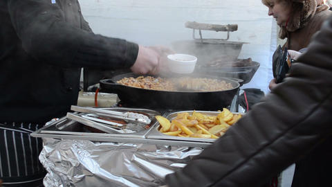 people buy pea potatoes meals outdoor event food bake pan vapour Footage
