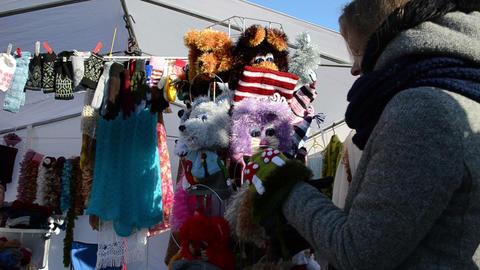 woman pick handmade wool knit kid caps spring fair market... Stock Video Footage